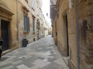 typical narrow street in Lecce, Italy